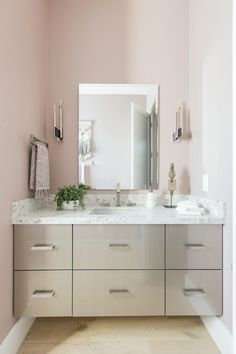 Located just off the home's foyer and great room, the simple and elegant powder room combines neutral tones with a touch of Southwest style.