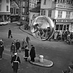FANTASTIC shot! That plastic bubble got around. Did he travel with it? (1963, Paris - Melvin Sokolsky)