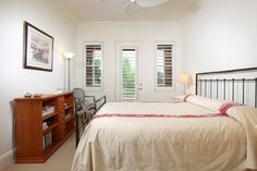 Guest bedroom with private balcony.