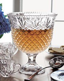 "$88.19 Give your buffet table an elegant focal point with the Shannon Crystal Punch set. Crafted by Godinger using techniques perfected by Bohemian crystal artisans, the set features an optical design that makes the bowl and cups sparkle. Includes a 10"" crystal punch bowl, silver-plated ladle, 8 cups and a 20"" round silver-plated serving tray. Hand wash. Imported."