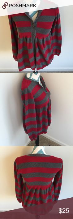 Calvin Klein Sweater Like new long sleeve gray and red stripped sweater. It buttons half way down and then flares out. So pretty! Made with 100% cotton. Bust measures 30 inches and length is 23.5 inches. No flaws! Calvin Klein Sweaters