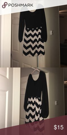 Dress Chevron print and used only twice. Sheer sleeves and scope necks on both sides Dresses Long Sleeve