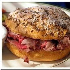 An easy roast beef sandwich with local origins in Buffalo, New York. Kimmelweck rolls are hard kaiser-type rolls covered in coarse ground salt and caraway seeds. This recipe transforms regular rolls into the traditional weck rolls.