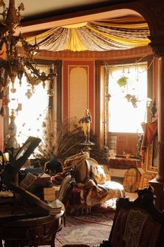 A late Victorian fancy was the Turkish corner. It was usually a small room, or nook that was outfitted with Moorish-inspired wallpapers, a fabric draped ceiling, exotic rugs (over rugs) curtains, and excess of pillows and upholstered furniture as well as moorish statues and egyptian revival pieces.