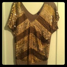 Gold Sequin Top This is a gorgeous sequined gradiated gold top. Really a gorgeous statement for a party or a night out! The fabric is soft and surprisingly the sequins don't make you itch. I'm open to offers! Forever 21 Tops Blouses