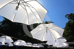 Umbrellas With Light In The Middle Stock Image - Image of rays, blue: 59789405 Umbrella Lights, The Middle, Umbrellas, Sunlight, Sky, Stock Photos, Blue, Image, Heaven