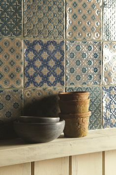 Patterned tiles combined to make a beautiful patchwork. Featuring beautiful blue hues on a Truffle background. Handmade ceramic tiles from the Chateaux collection by The Winchester Tile Company. winchestertiles.com