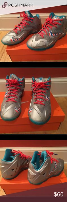 Nike LeBron XI size 6Y Nike LeBron XI in metallic silver with a patriotic red/white/blue swoosh, red laces and a blue bottom. Nike Shoes Sneakers