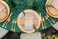 Wizard of Oz wedding.  Green reception tablescape. Emerald City table.  Rainbow pastel menus.  Gold flatware. http://www.fandomaffairs.com/gallery/
