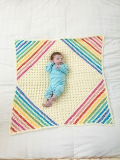 "The ""Nobody Puts Baby in the Corner"" Blanket is the cutest and aptly named baby afghan we've ever had! It's essentially a solid granny square with a rainbow pattern at the corners."
