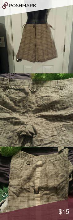 Plaid shorts Super cute pair of brown and tan plaid shirts from Gianni Bini.  Runs closer to a 10 Gianni Bini Shorts