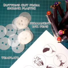 Make your own button using:  Shrinky Dink paper (frosted),  ZIG millennium pens,  Fiskar Squeeze Circle punch - large,  template for art (http://dl.dropbox.com/u/13390498/buttons%20template.png) or make your own.  Be sure to test the them to see if they are colorfast in your washer before sewing them to your clothing - ZIG is supposed to be the best permanent marker so don't substitute