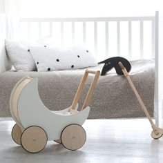 Ooh Noo - Toy Pram - White: This toy pram is just too cute for words. It is made entirely of wood, with the exception of the tiny tires on the wheels Sofa Furniture, Kids Furniture, Furniture Market, Outdoor Furniture, Baby Toys, Kids Toys, Pram Toys, Luxury Furniture Brands, Kids Room Design