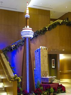 Pic 7  Gingerbread CN Tower | This giant gingerbread tower currently resides in Toronto's Ritz Carlton. At 17 feet tall, it's a super cool (and tasty) tribute to the real landmark, which clocks in at an impressive 1,815.4 feet.  | 10 amazing gingerbread houses |  Today's Parent