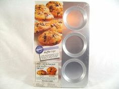 """Wilton Muffin Caps Pan by Wilton Enterprises. $19.99. Bakes only the best part of the muffin """"The Top"""".. Dishwasher Safe-Won't Rust. Even heating for uniform baking and browning. Muffin Caps. 1/2 inch deep. Quality aluminum produces six-rich, chewy textured muffin tops. Recipes and baking instructions included."""