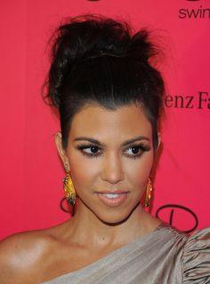 Kourtney Kardashian - Around Mercedes-Benz Fashion Week Swim 2011