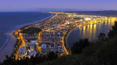 Mt Maunganui, Pacific Ocean beach, and harbour, North Island East Coast. . New Zealand. Photo by blue polaris on Flickr.