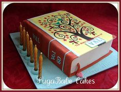 Sweet! So well done! A book cake with the candles on the side so no wax drips on the icing (by SugaBabe Cakes)