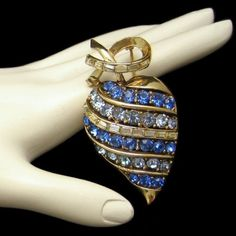 CORO VINTAGE APPLE/HEART! A vintage Coro brooch shaped like an apple or heart with sparkling blue rhinestones and clear baguettes in a swirl design! $76.50 See More Wonderful Vintage Brooches in My Shop: https://www.etsy.com/shop/MyClassicJewelry?section_id=13113948 :)