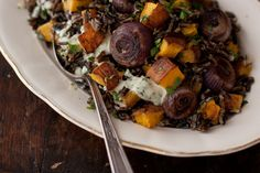 Roasted Pumpkin Salad. 'A roasted pumpkin salad made with wild rice, tiny, caramelized red onions drizzled with a simple, honey-kissed, creamy sunflower seed dressing.'