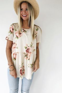 "Ivory Peplum Blouse Blush + Green Floral Short Sleeve Rounded Neckline Back Keyhole w/Ribbon Tie Loose Fit Model is 5'9"" + Wearing a Small"