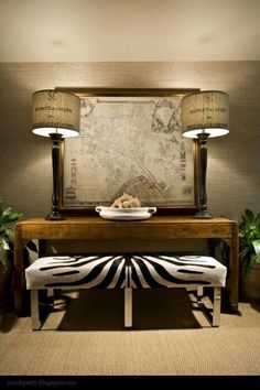 Zebra Skin Ottoman, and Sea Grass Wallcovering. Handsome Room. by ursula