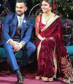 Anushka Sharma's engagement sari was designed by Sabyasachi Mukherjee. The velvet sari in the hue was hand-embroidered with miniature pearls, zardozi and marori. Anushka Sharma Engagement, Engagement Saree, Engagement Dresses, Engagement Jewellery, Anushka Sharma And Virat, Virat Kohli And Anushka, Anushka Sharma Saree, Groom Outfit, Groom Dress