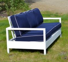 White outdoor couch with blue cushions.  DIY Plans on website