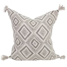 Shop our one of a kind block printed collection of linen pillows online. This white and grey geometric designer cushion has been hand block printed by artisans in India.