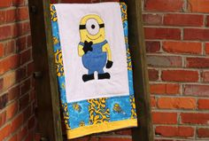 Despicable Me Minions baby quilt gift set with matching burp cloths. Custom made at Knotted Line Design. $69. Order yours today! www.knottedlinedesign.etsy.com