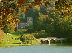 Stourhead Church and bridge, Autumn Stourhead garden, with its lake and C18 classical features, is one of the finest landscapes in the world.