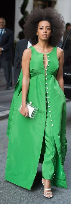 Solange Knowles wore a kelly green jumpsuit and dress cape from Rosie Assoulin's Fall 2015 collection while out in New York City.