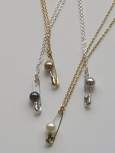DIY safety pin necklace. Might be a good use for those single earring beads!