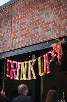 drink up marquee lights | photo: the mondays | see more: http://emmalinebride.com/decor/bright-pink-wedding-ideas/