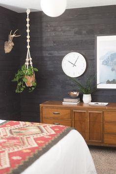 This boho bedroom puts a modern twist on trendy shiplap. With a simple black paint stain, it couldn't be easier to makeover your master suite with a similar bold aesthetic. Shiplap Bathroom, Wainscoting, Bedroom Ideas, Home Decor Bedroom, Diy Home Decor, Wood Bedroom, Bedroom Loft, Bedroom Inspo, Painting Shiplap