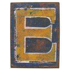impress your friends with a vintage look by adding this rustic iron wall letter e