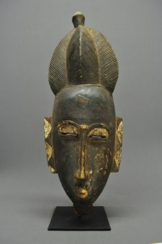 Africa | Carved wood Baule mask comes from the Ivory Coast. There are traces of white pigment.