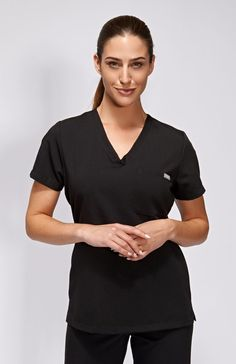 f9db02d3539 The women's Catarina scrub top has a slim fit while allowing free and easy  movement. FIGS