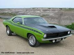 """1970 AAR 'Cuda:  340 Trans-Am V8, factory fibreglas hood and rear ducktail spoiler, blacked-out grille, dual exhaust exiting before the [wider] rear tires, special AAR badging and doppler striping, radio antenna relocated to the rear quarter-panel, and ALL in a beautiful """"Sassy Grass"""" green paint job ... AWESOME!!!"""