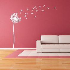 """Adesivo Murale - Soffioni. Le dimensioni si riferiscono allo stelo. I petali soffiati dal vento possono essere applicati a piacimento. Adesivo murale di alta qualità con pellicola opaca di facile installazione. Lo sticker si può applicare su qualsiasi superficie liscia: muro, vetro, legno e plastica. L'adesivo murale """"Soffioni"""" è ideale per decorare soggiorno e camera da letto. Adesivi Murali."""