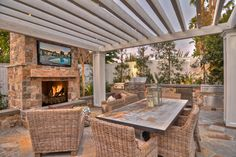 The outdoor pavilion with chef's kitchen and bar, stone fireplace and flat screen tv creates the perfect lounge while relaxing by the sparkling pool and spa.  Mature landscaping in the park like setting brings a sense of absolute privacy.