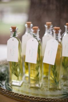 Fragrant olive oil favors can also double as table numbers. Photo Source: wedding chicks #weddingfavors #oliveoil
