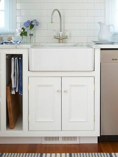 A pullout towel rack lets damp towels air-dry where they're stored.