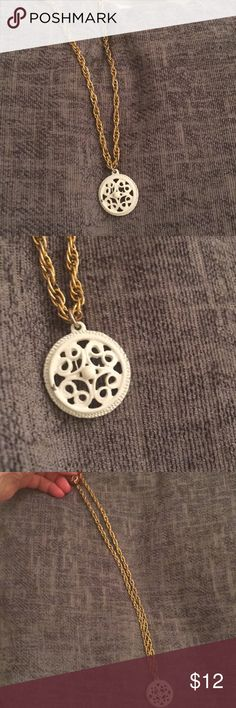 1960s cute white enamel boho bronzy rope necklace 17 inch rope necklace with one inch white enamel metal scalloped filigree pendant. Patina gold is dark and bronzed. And circle pendant does has one tiny paint flaw. See photos. Love this one. Jewelry Necklaces