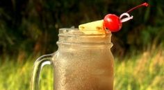 Swamp Thing    Rum Peach Schnapps Blue Curaçao Orange Juice Grenadine Garnish Fill a large mason jar with ice, 6 count of Rum, then add other ingredients and stir. Add garnish