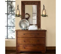 """Love how the mirror matches, but doesn't match. And the sconces. This one is 48""""x22""""x36"""" and its $899. Sumatra Dresser 