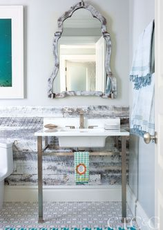 Knapp installed Stikwood on the walls in a busy downstairs bathroom. Her painter transformed the mirror to match.