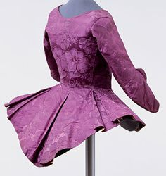 Woman's jacket of purple silk damask, Germany, c. 1750-1770. The large protruding basques once lay decoratively on a hooped petticoat
