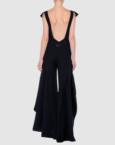 How awesome is the back? And the fluttery, layered legs are to die for. (The description says it's a skirt, but it looks like a jumpsuit to me...and I think it's more awesome as a jumpsuit than a dress!) Silvio Betterelli for Andre' Lang, $2669.