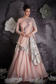 Shop online designer peach silk and organza gown. Peach silk and organza gown with rich work on it that suits for any formal parties or evening parties.